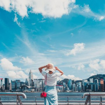 Young woman looks out over the Hong Kong skyline